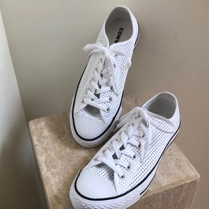 Converse All Stars. All white open weave.